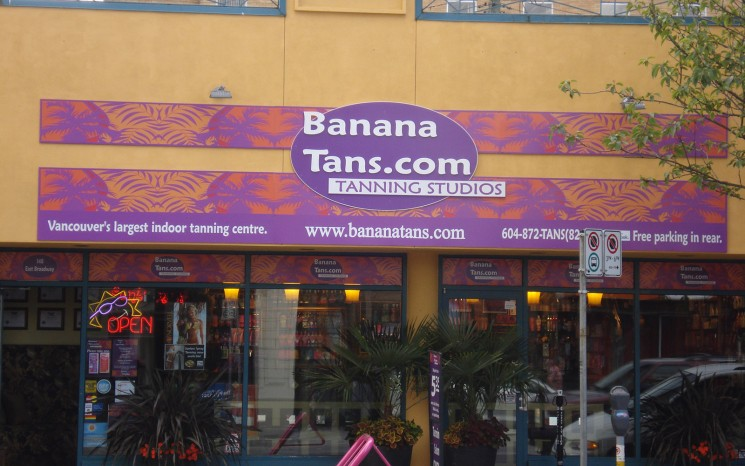 Full coloured routered and laminated graphics storefront sign