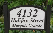 Routered, primed and painted western red cedar wood development project sign for Marquis Grande