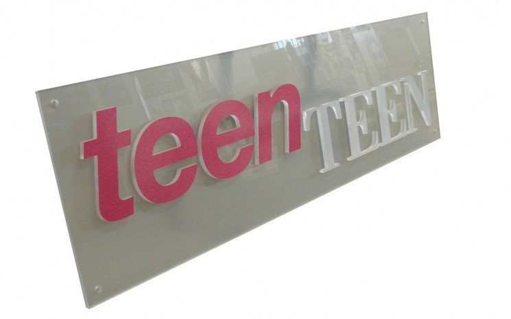 Acrylic 3D lettering mounted on acrylic business sign
