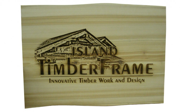 Laser etched graphics on fir wood business sign