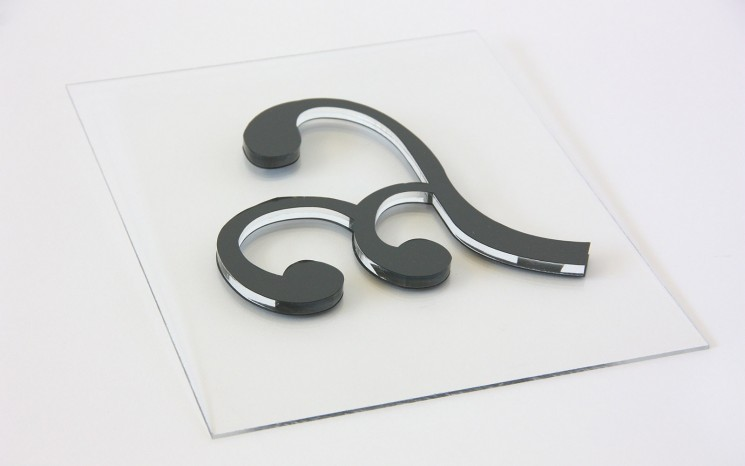 Laser cut acrylic with grey adhesive vinyl face movie set prop