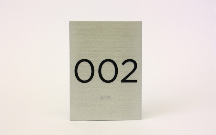 Tactile lettering and raster bead braille brushed aluminum ADA sign