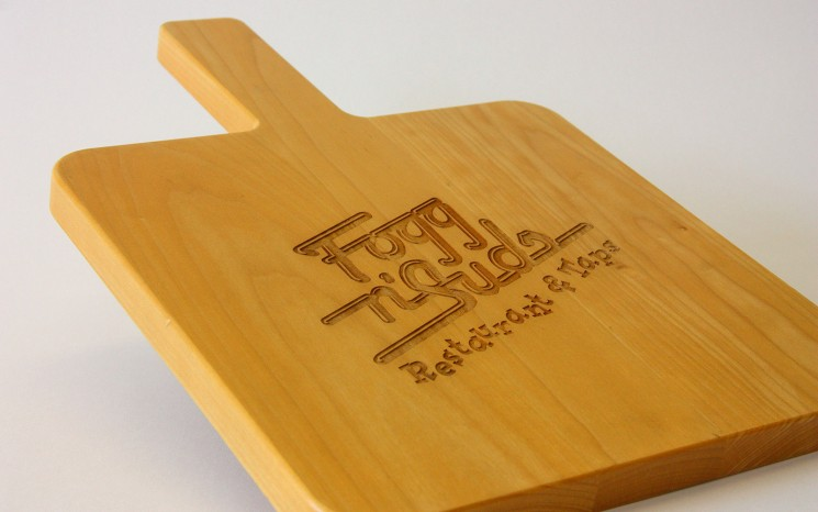 Custom made maple wood serving board with laser engraved logo