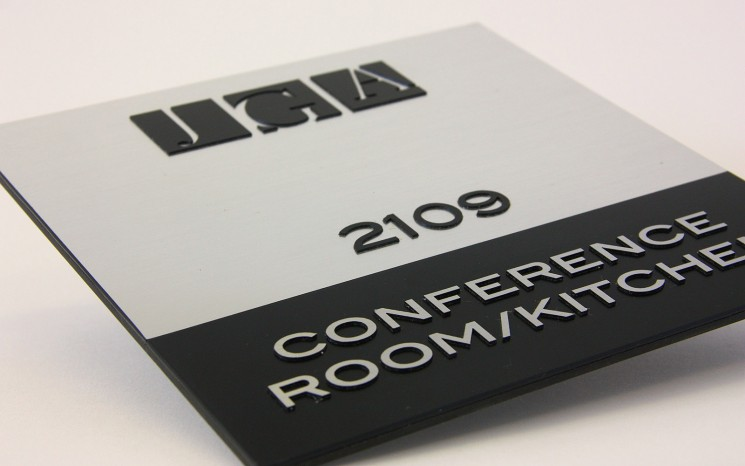 Raised lettering brushed aluminum wayfinder/directional sign