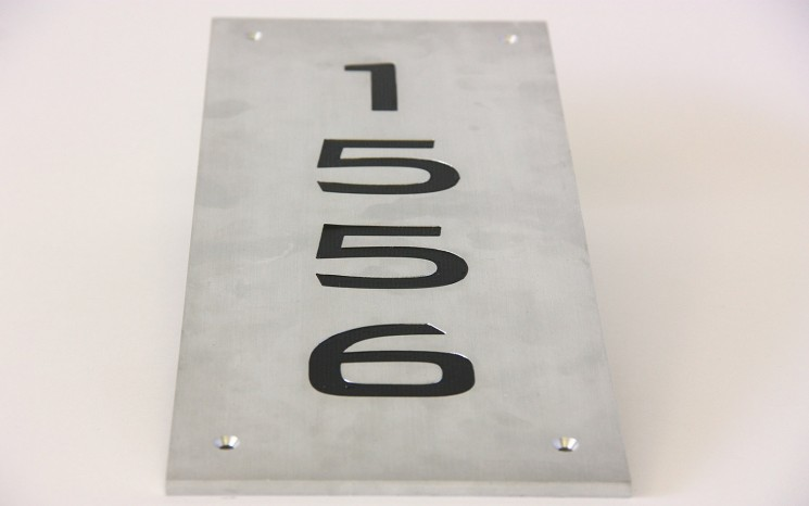 Engraved hand brushed satin aluminum wayfinder/directional sign