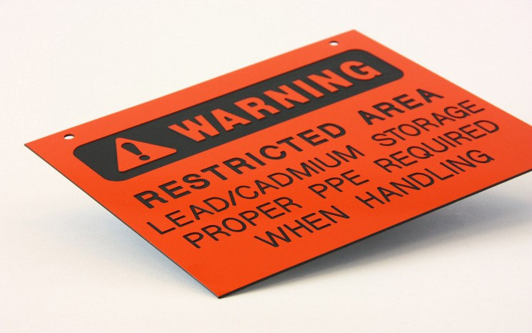 Laser engraved plastic warning directional sign