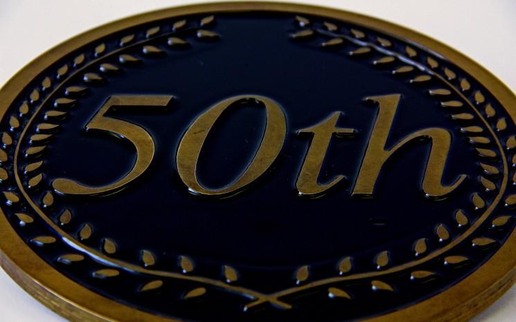 Engraved brass and back in-filled black award