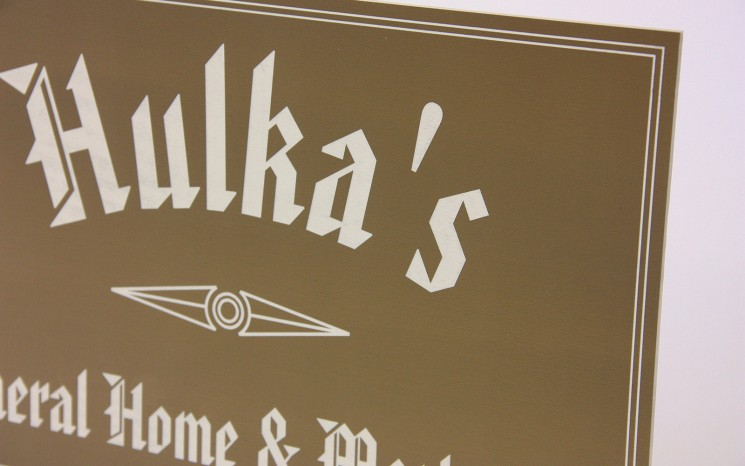 Laser engraved graphics business sign