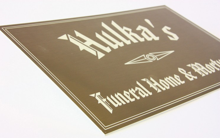 Laser engraved graphics business sign