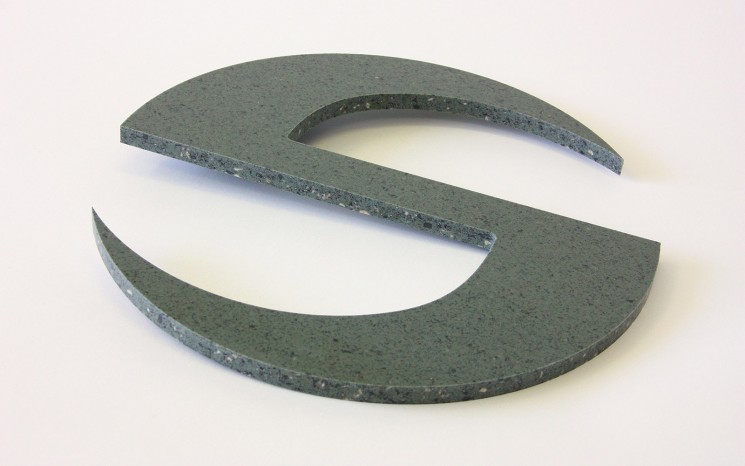 Routered Corian symbol