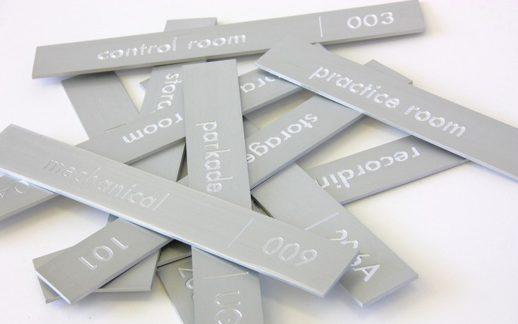 Engraved clear anodized aluminum wayfinder/directional signs