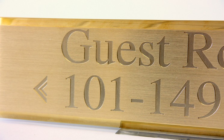 Engraved brush faced brass wayfinder/directional sign