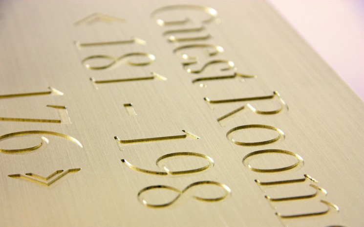 Engraved brush faced brass wayfinder/directional sign