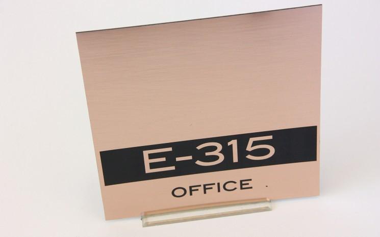 Laser engraved brushed copper plastic wayfinder/directional sign