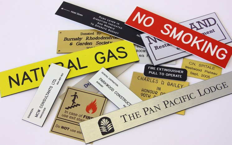 Engraved plastic and brass wayfinder/directional signs