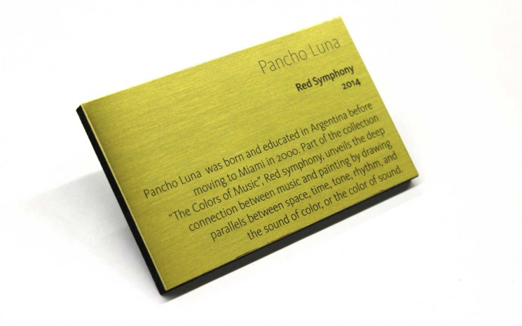 Brass plaque with burnished and blackened text on a 1/4″ black sintra backer